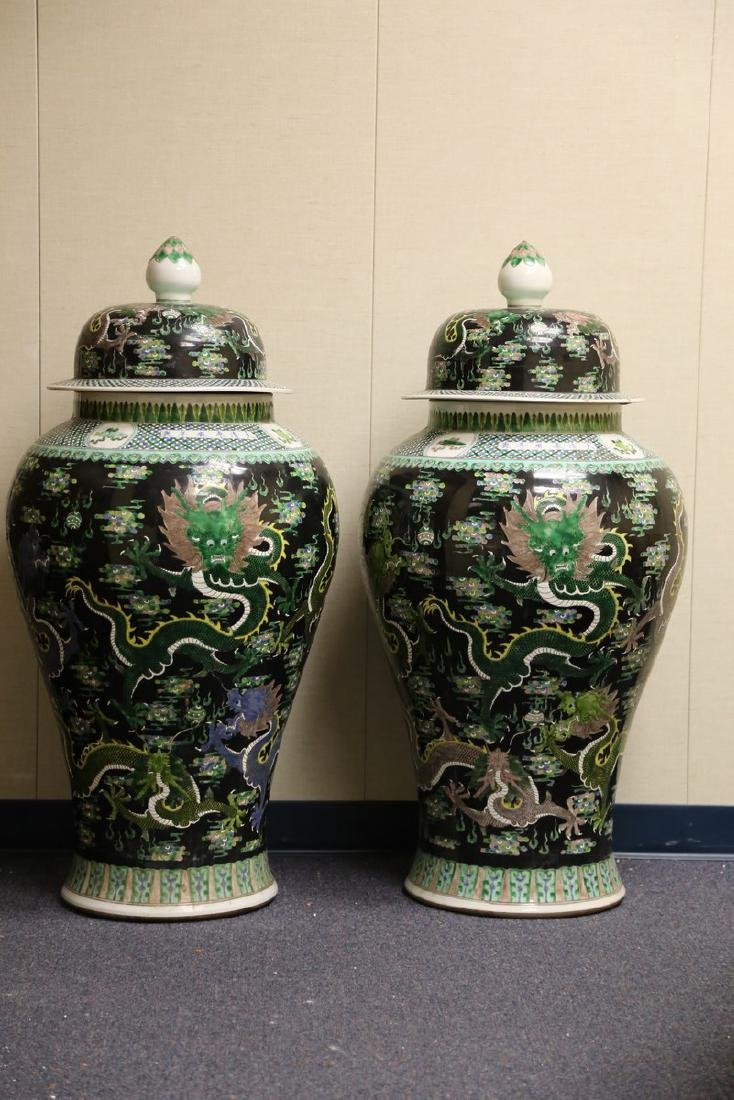 A Pair of Massive Famille Noire Enameled Porcelain