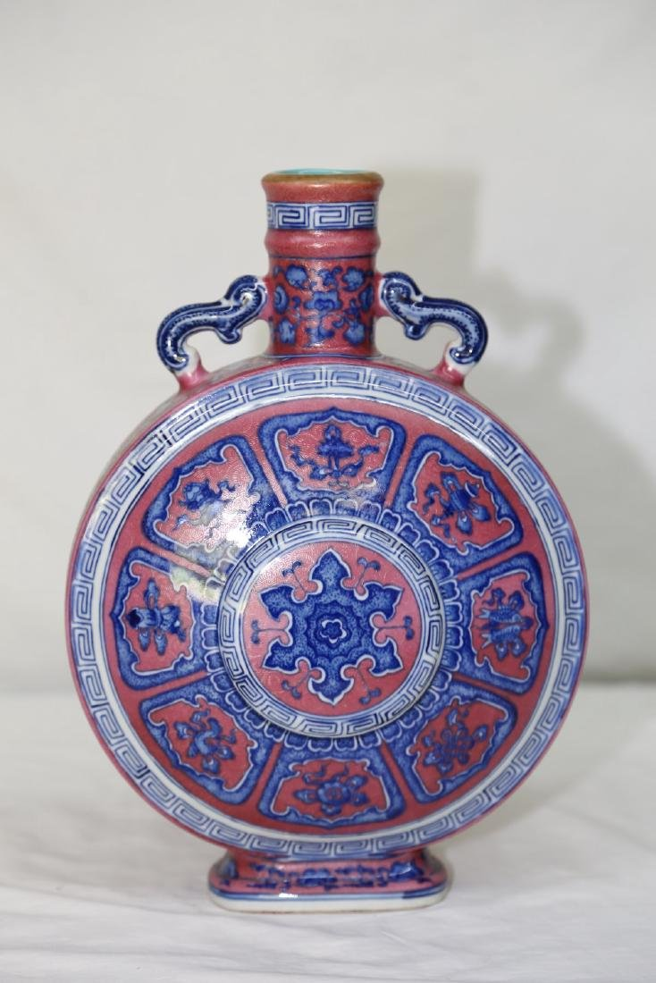 An Iron-Red Ground Blue and White Porcelain Moonflask