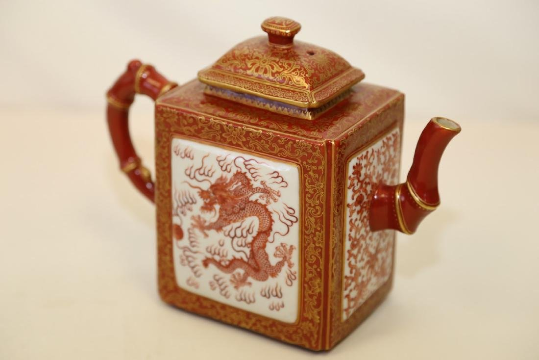 A Fine Iron-red and Gilt-painted Dragon Teapot