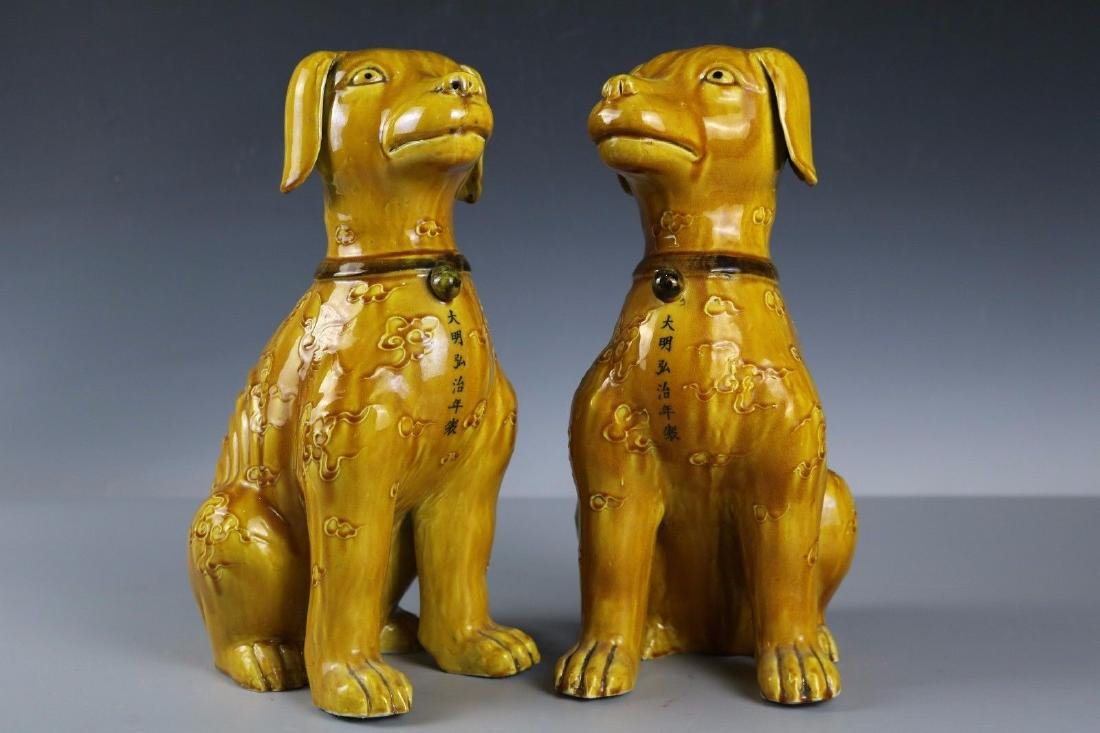 A Pair of Yellow Glaze Porcelain Dogs