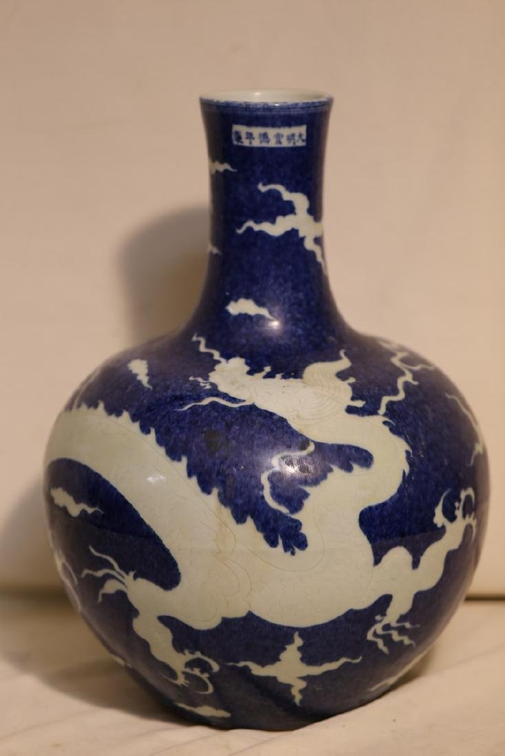 A Reverse Blue Ground and White Dragon Vase