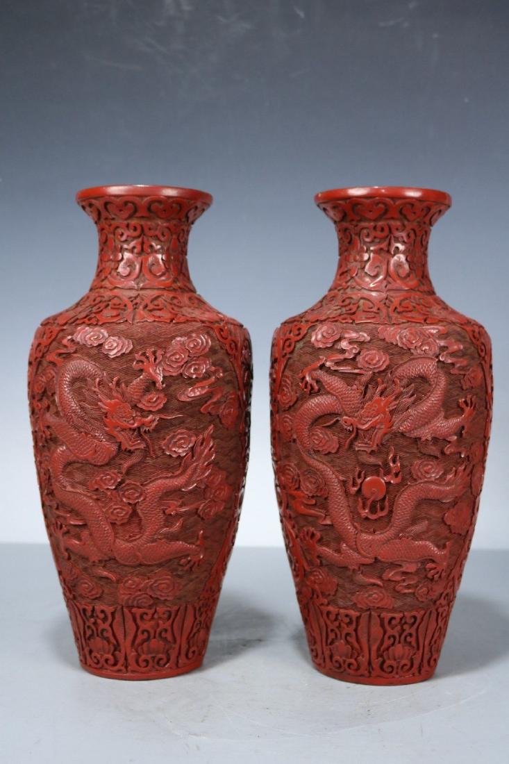 A Pair of Carved Lacquer Vases