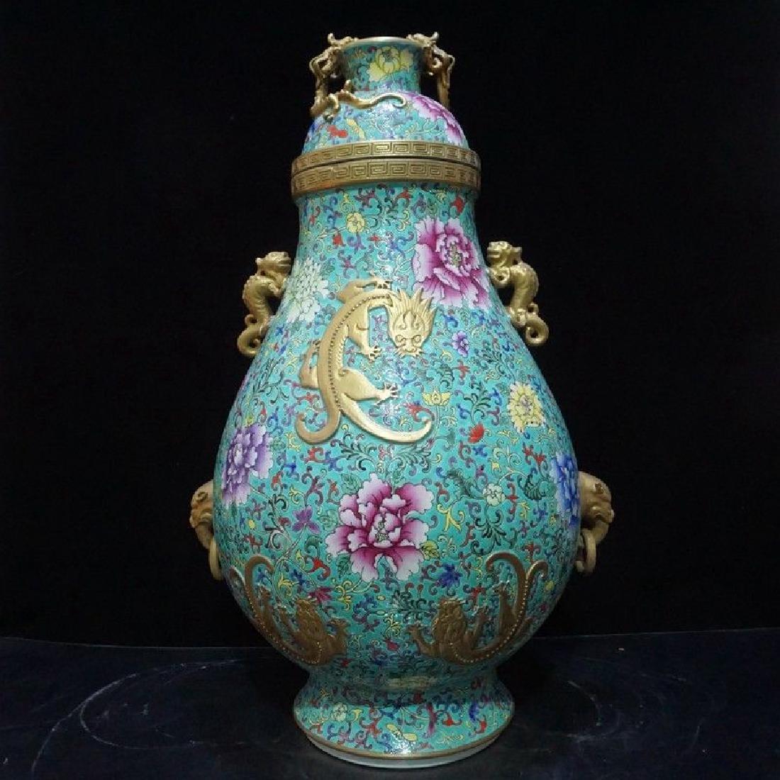 A Famille Rose and Gilt Decorated Porcelain Vase