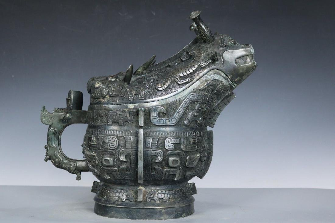 An Archaic Bronze Ritual Food Vessel and Cover