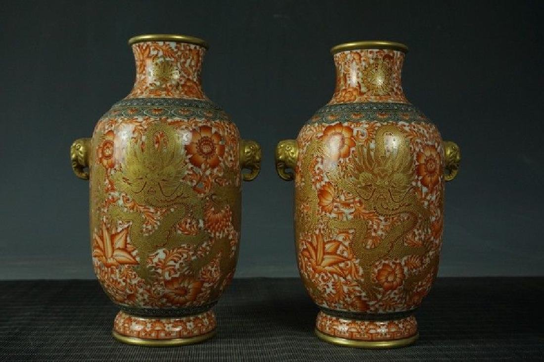 An Extremely Rare Pair of Famille Rose Porcelain Vases