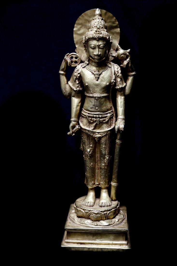Gold standing statue of Shiva