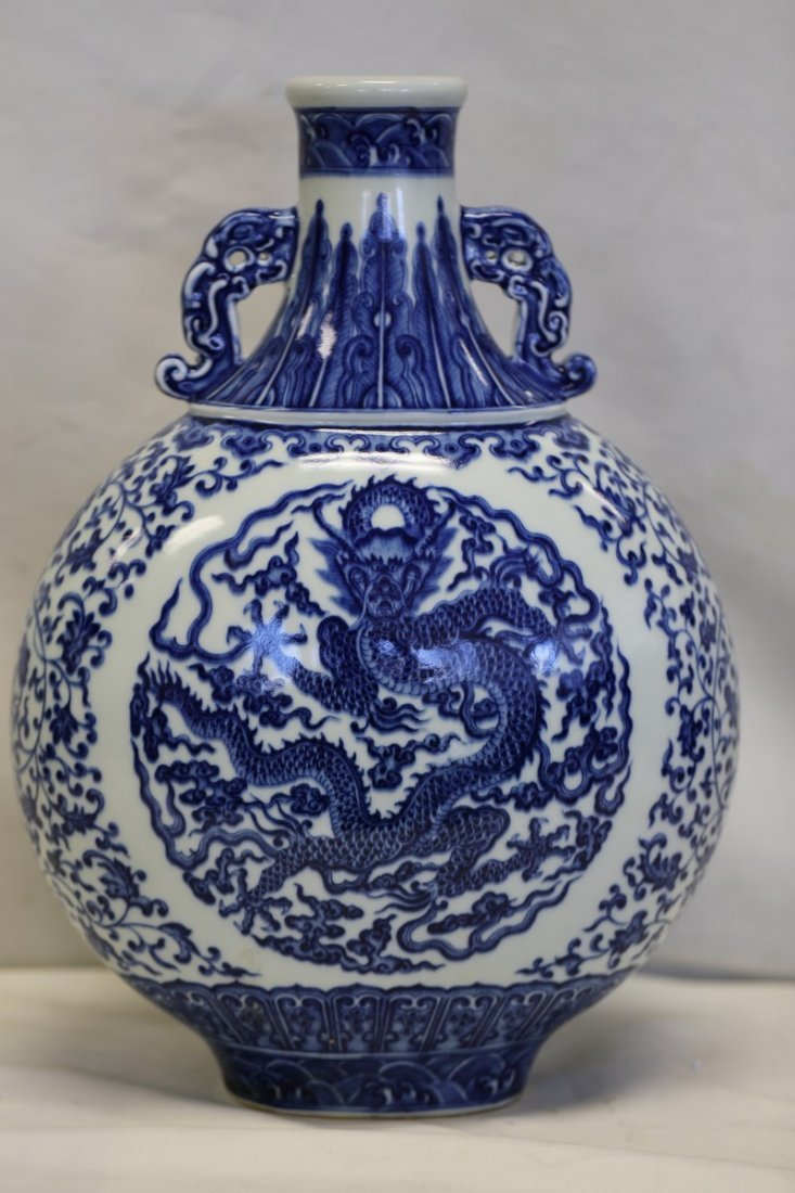 A Magnificent Blue and White Dragon Moon Flask