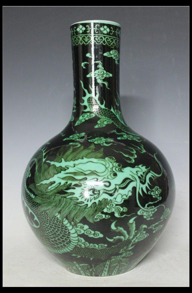 A Black-Glazed and Green Dragon Vase