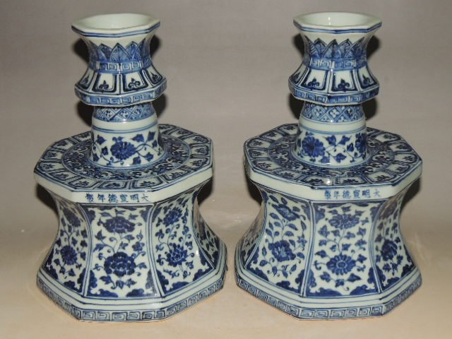 A Pair of Blue and White Candle Holders