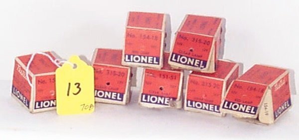 13: 7 Boxed Lamps: Two 151-51 12V Clear, Two 154-18 14V