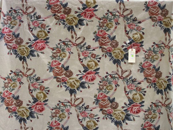 1961: Needlepoint floral rug, machine made