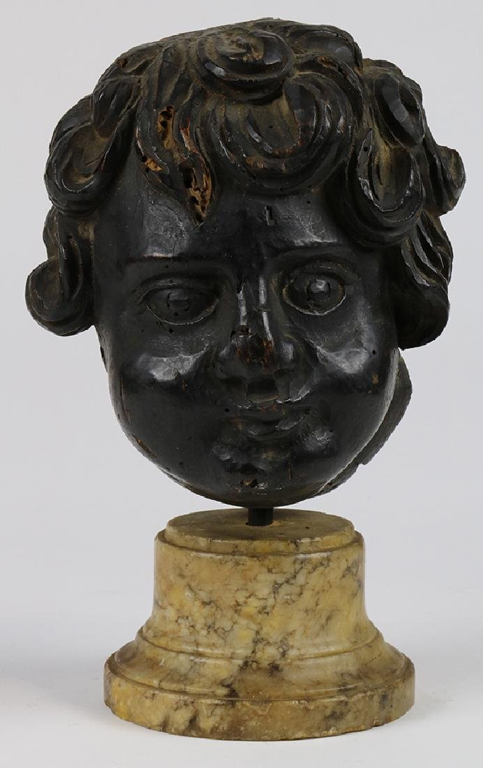 Spanish Colonial carved wood cherub head, 18th century,