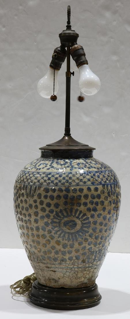 Early Persian pottery jar mounted as a lamp, having a