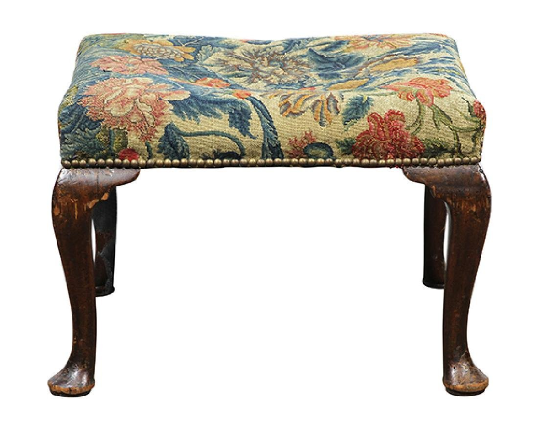Queen Anne needlepoint upholstered ottoman circa 1770,