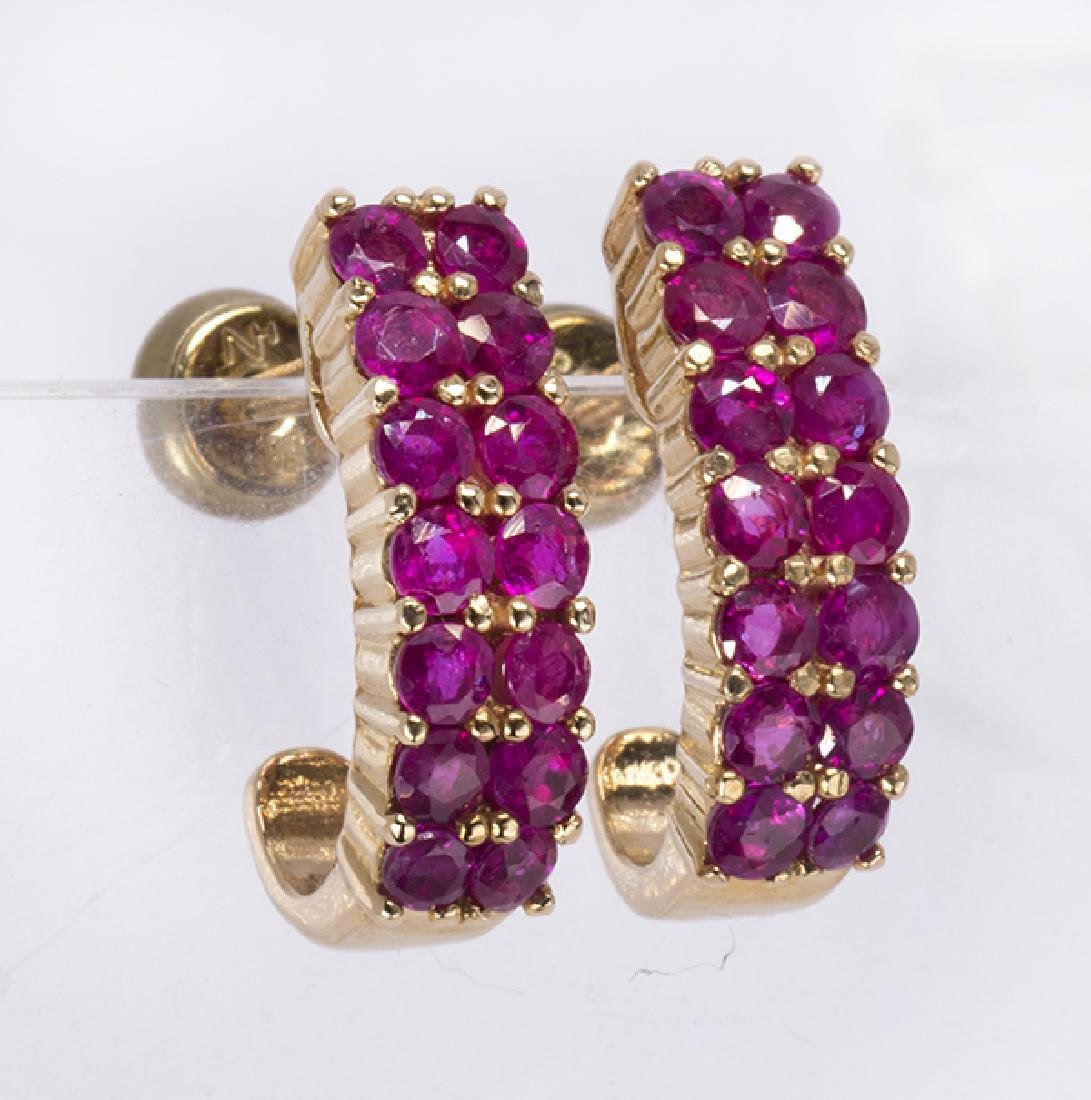Pair of ruby and 14k yellow gold earrings