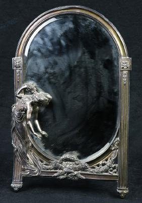 Art Nouveau silvered dresser mirror, the oval looking