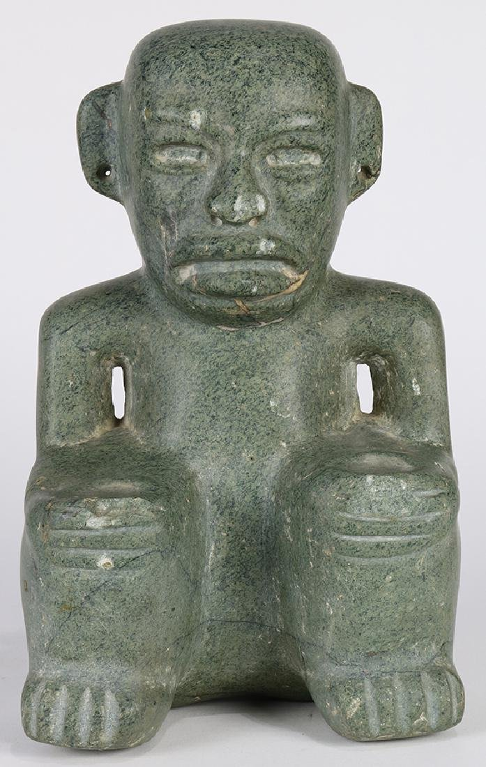 Pre-Columbian Olmec style carved stone figure, depicted