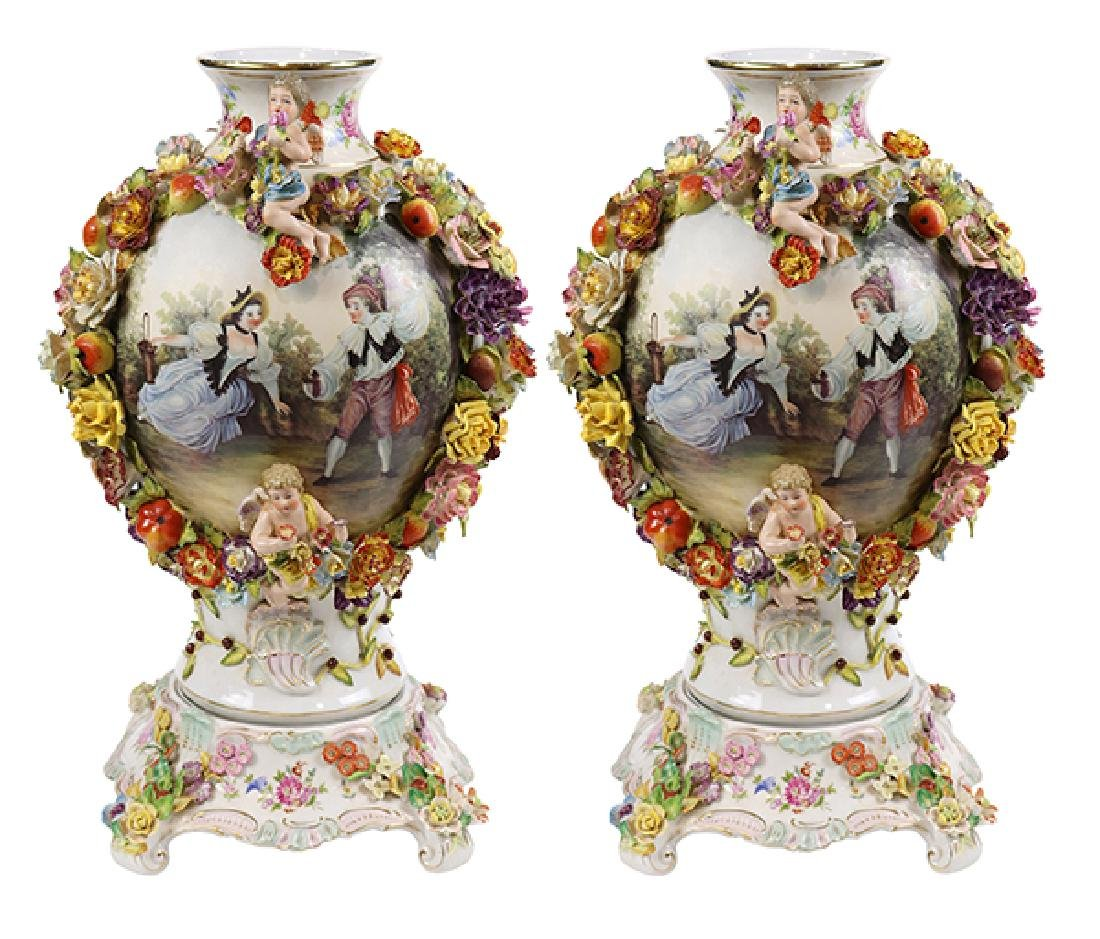 Pair of Dresden porcelain palace size urns, originally