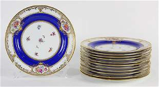 (lot of 12) Dresden parcel gilt service plates, having