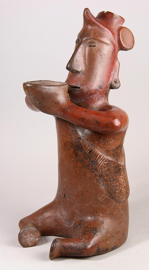 Colima red pottery seated shaman, Proto-Classic, 200 BC