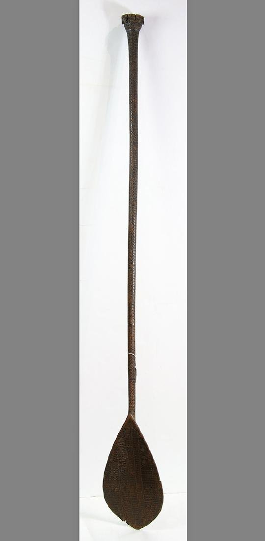 Austral Islands ceremonial paddle, on the longer