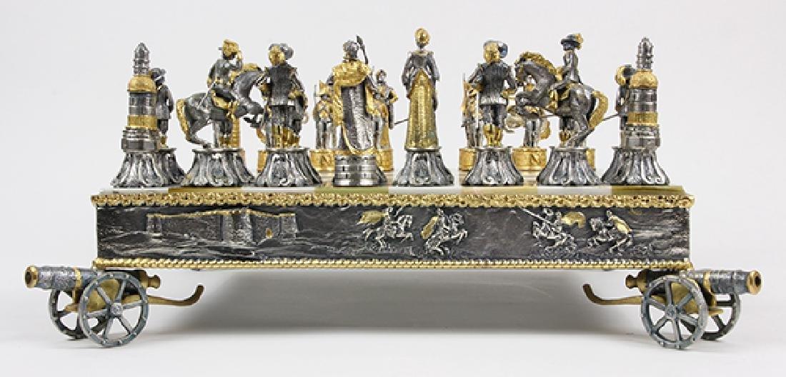 Giuseppe Vasari gilt metal chess set and board,  circa - 10