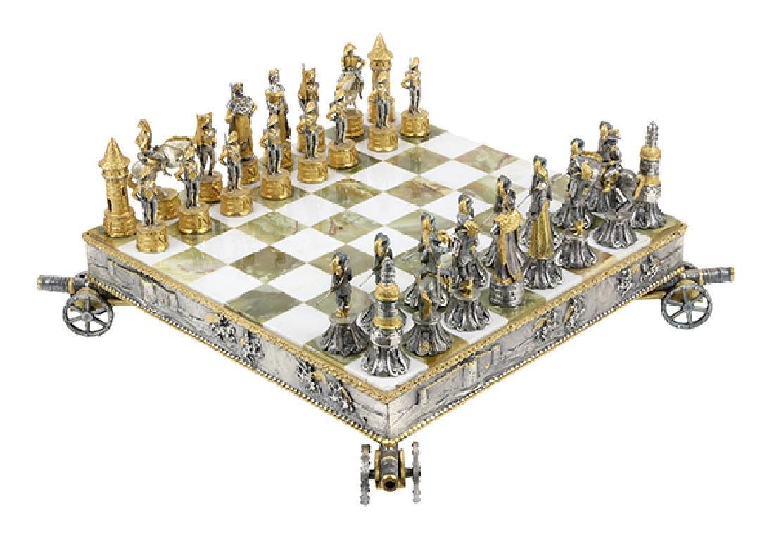 Giuseppe Vasari gilt metal chess set and board,  circa
