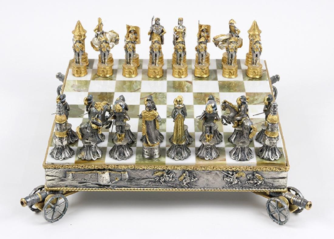 Giuseppe Vasari gilt metal chess set and board,  circa - 2