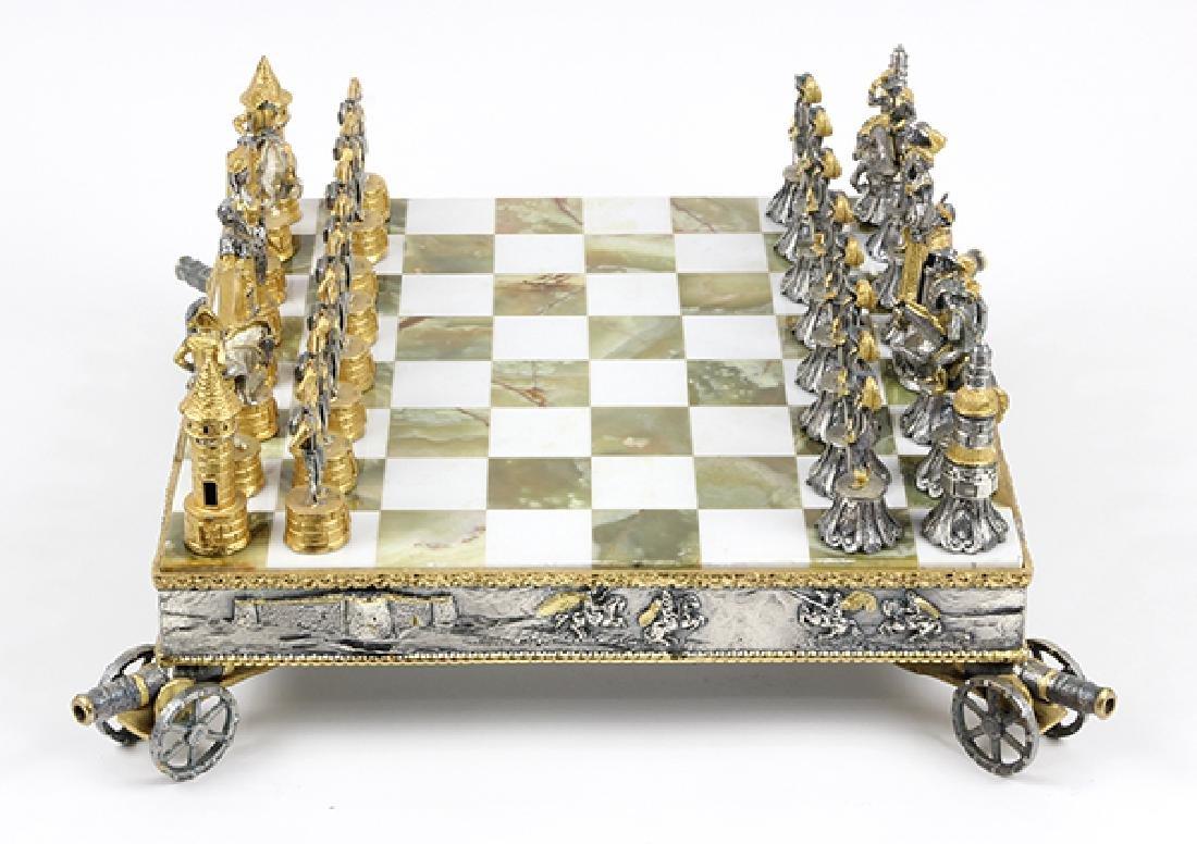 Giuseppe Vasari gilt metal chess set and board,  circa - 3