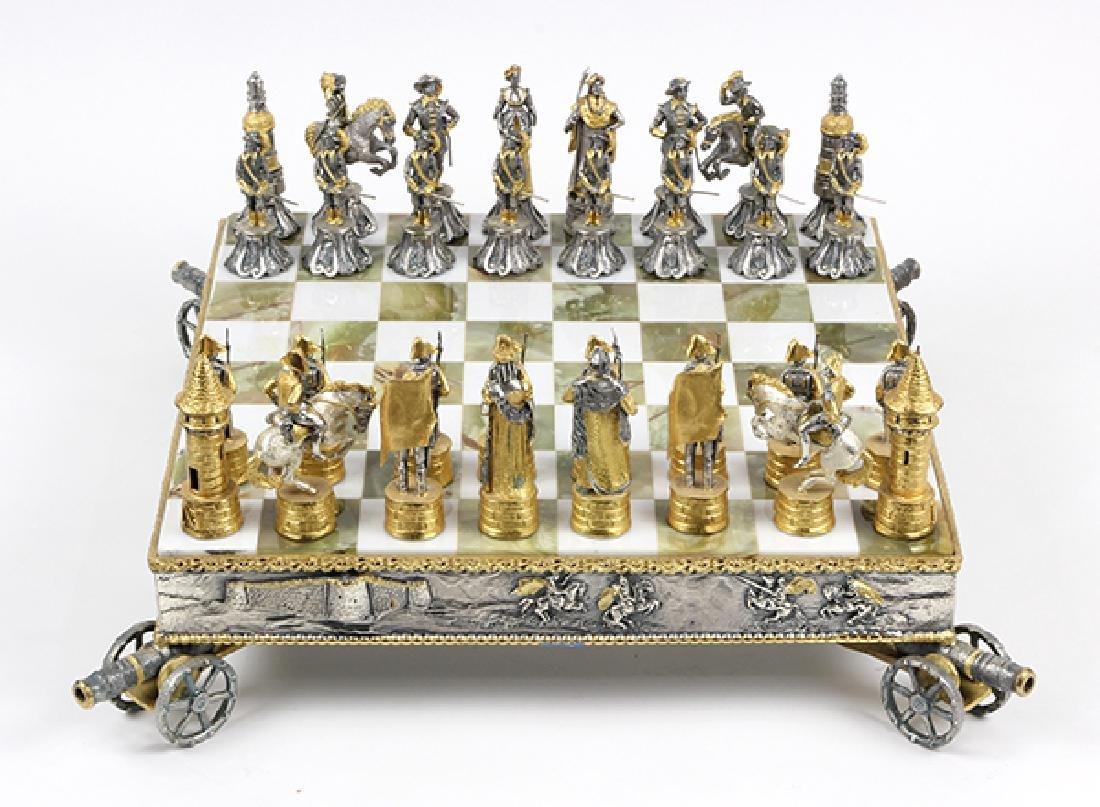 Giuseppe Vasari gilt metal chess set and board,  circa - 4