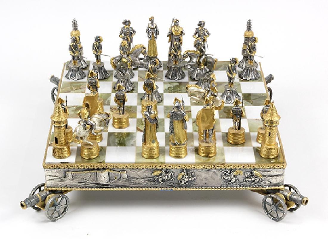 Giuseppe Vasari gilt metal chess set and board,  circa - 5
