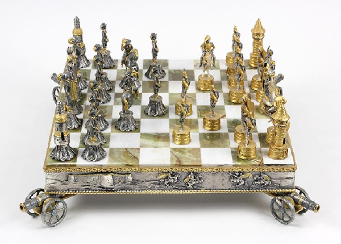 Giuseppe Vasari gilt metal chess set and board,  circa - 6
