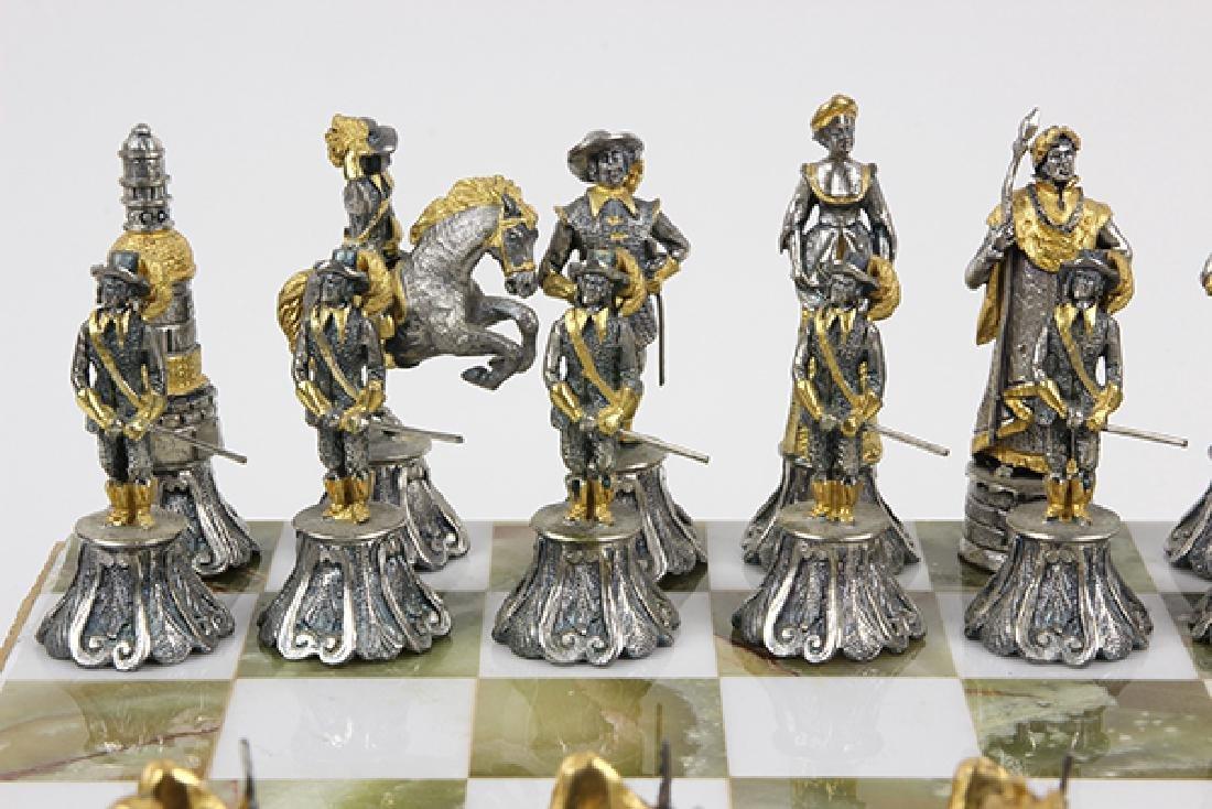 Giuseppe Vasari gilt metal chess set and board,  circa - 8