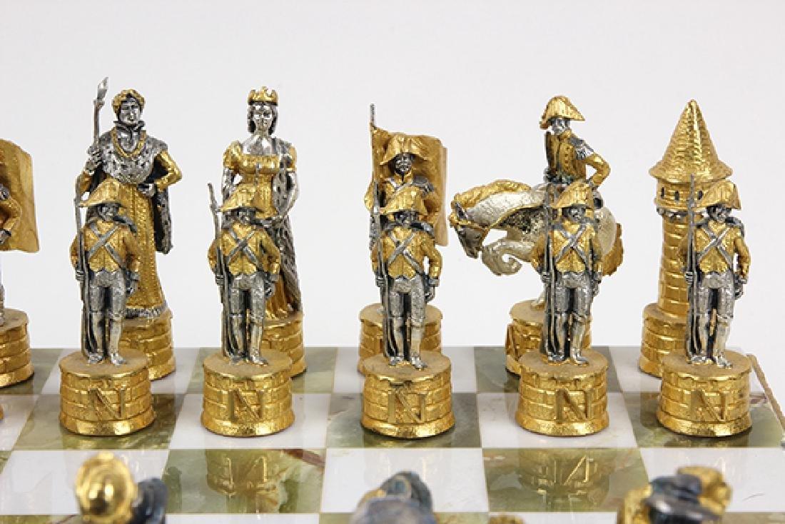 Giuseppe Vasari gilt metal chess set and board,  circa - 9