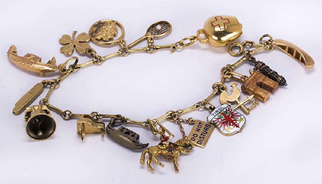 Yellow gold, silver and metal charm bracelet