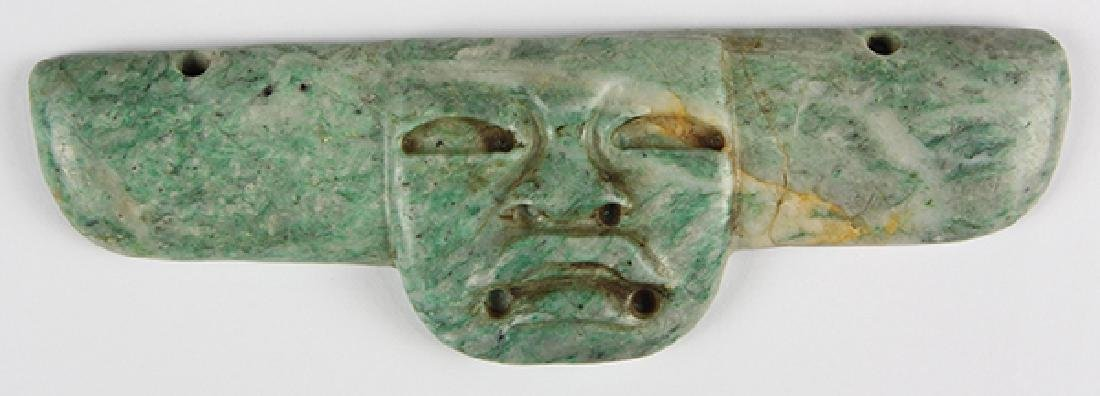 An Olmec-style jade pendant in a form perhaps based