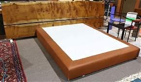 Enzo Bellini custom bed having a slab California myrtle