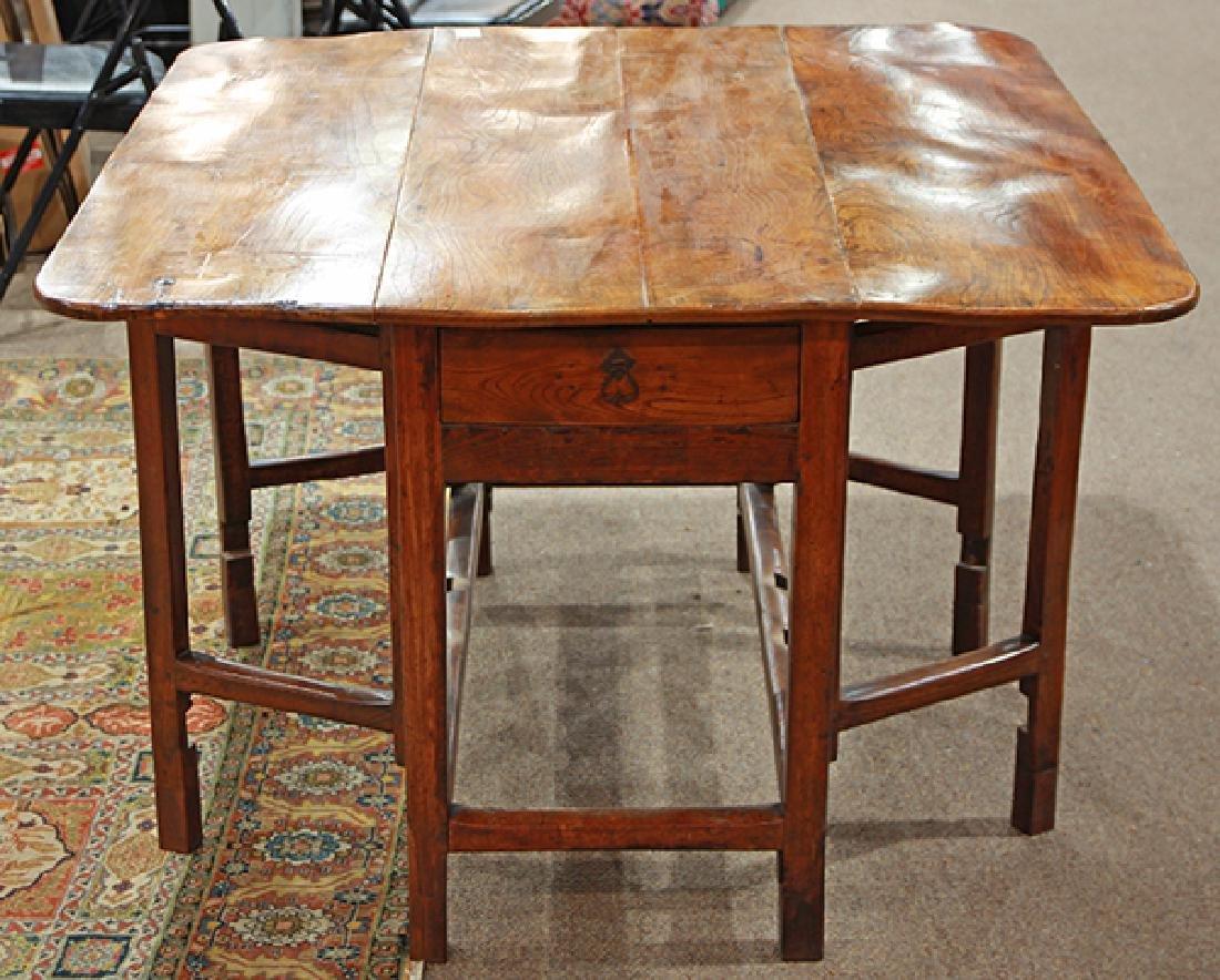 Continental elmwood drop leaf gateleg table