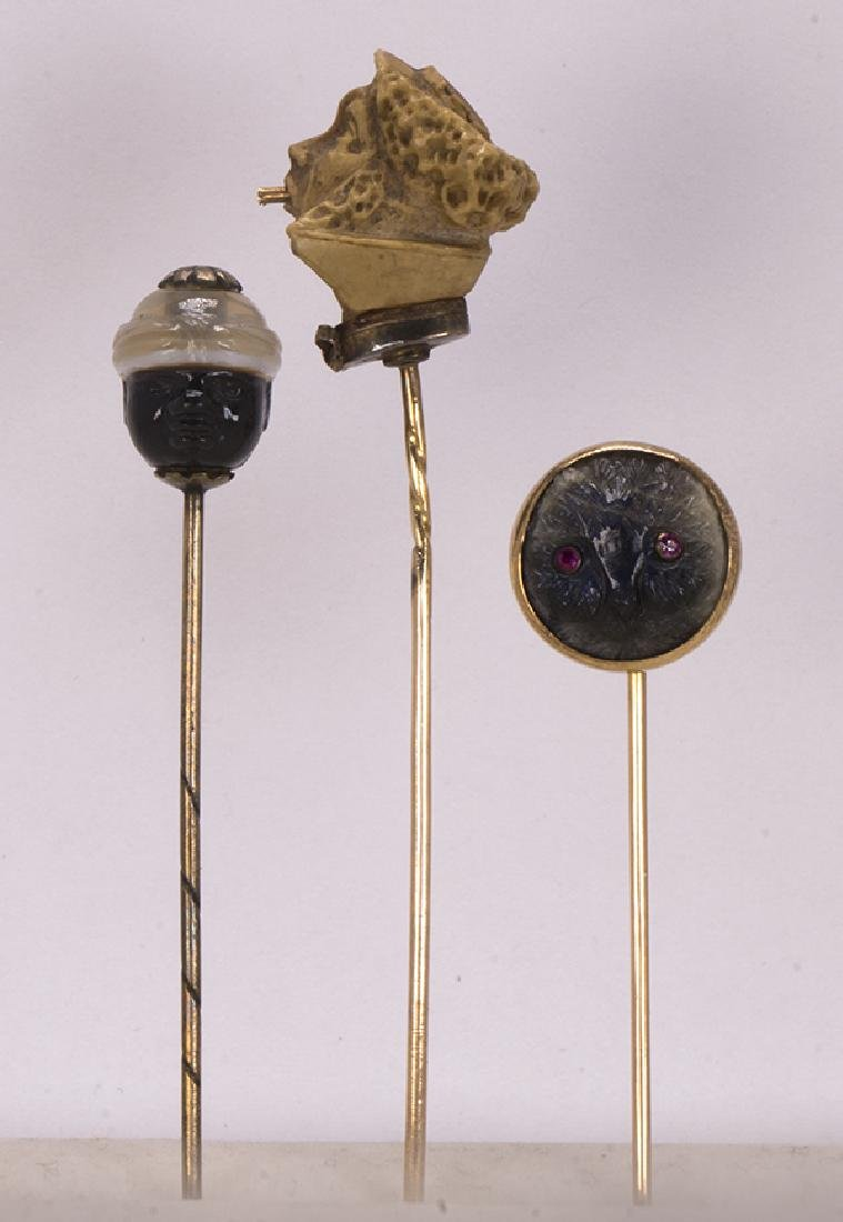 (Lot of 3) Carved multi-stone and gold stickpins