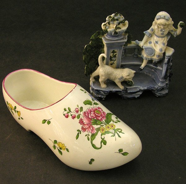 13: French porcelain figural group shoe