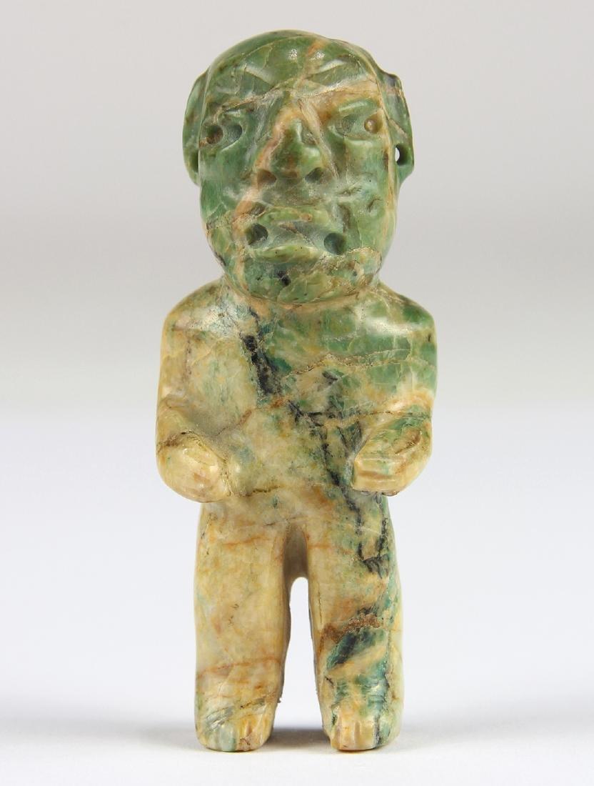 An Olmec or Olmec-style green jadeite figurine,
