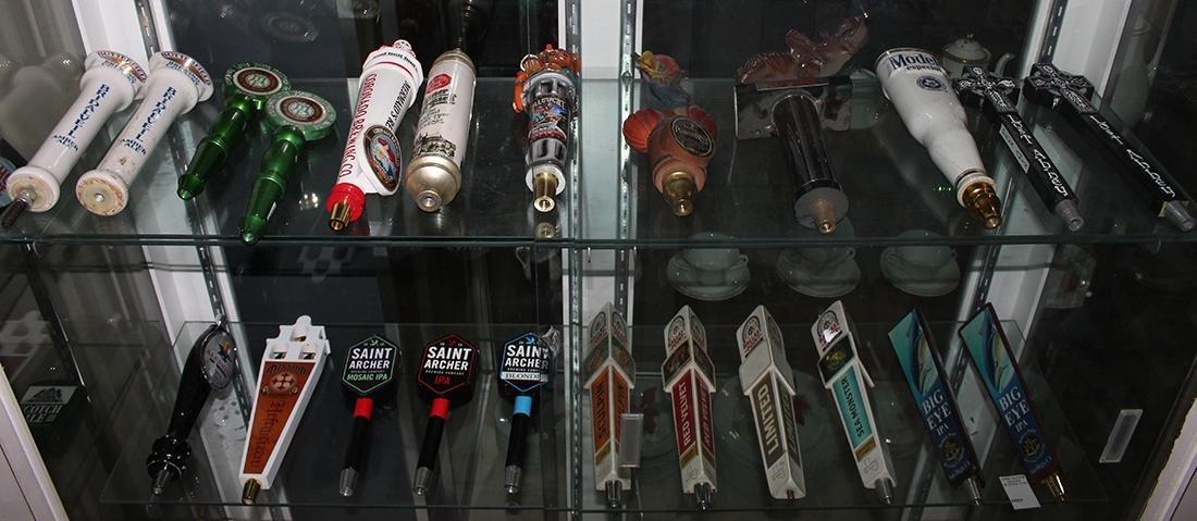 (lot of 34) Beer tap handles, including Coronado