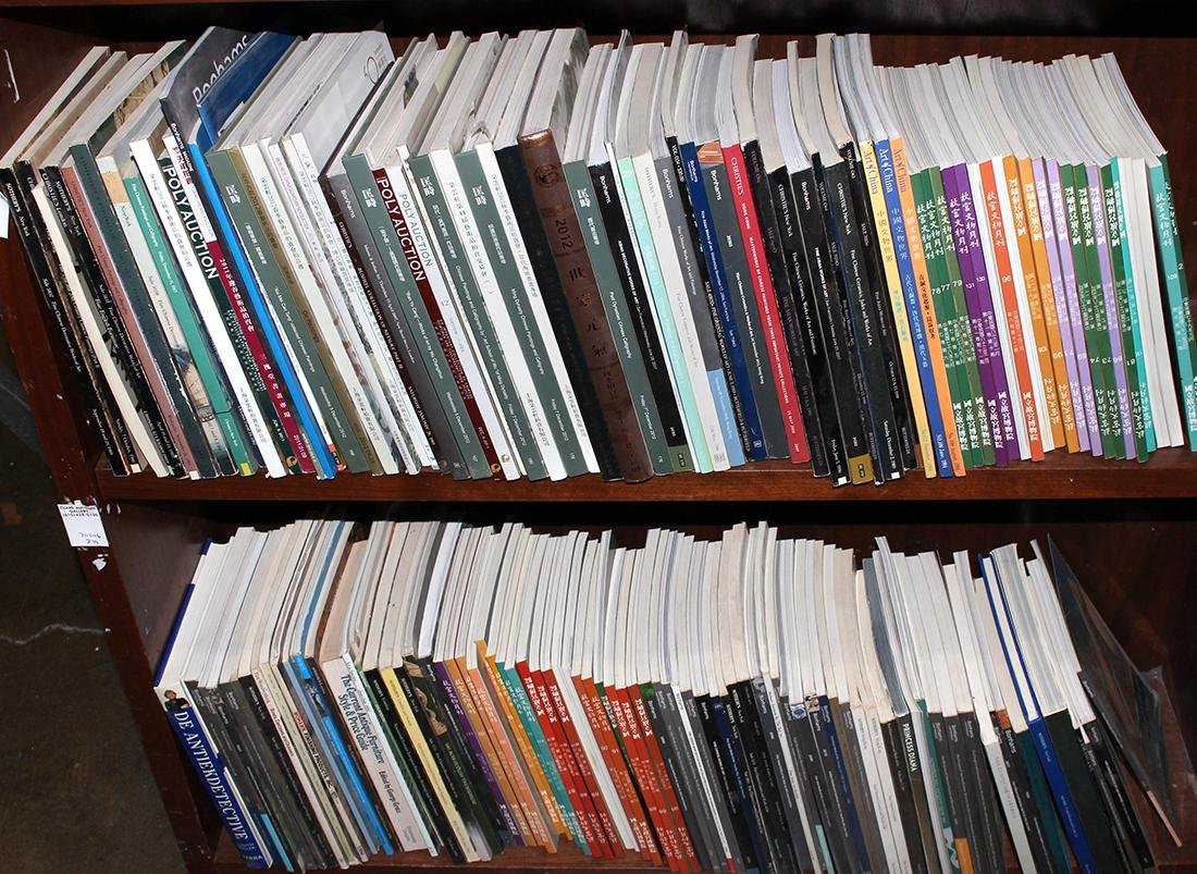 Two shelves of auction catalogs including Chinese