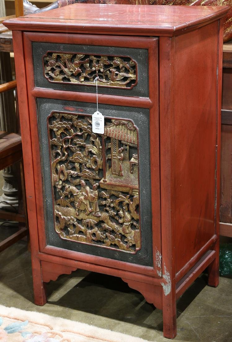 Chinese gilt lacquered cabinet, fronted by a hinged