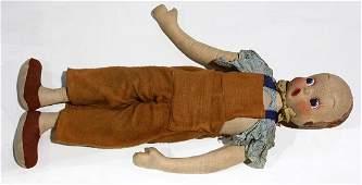 Folk Art life size doll having a sculpted canvas face
