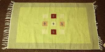 Navajo style flatweave rug having a light green field