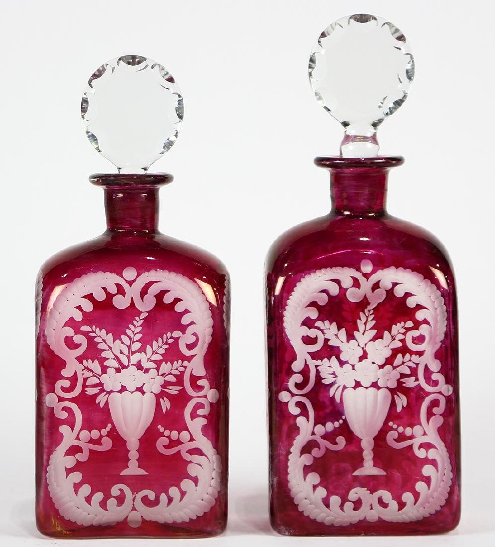 Pair of Bohemian blown glass decanters, executed in
