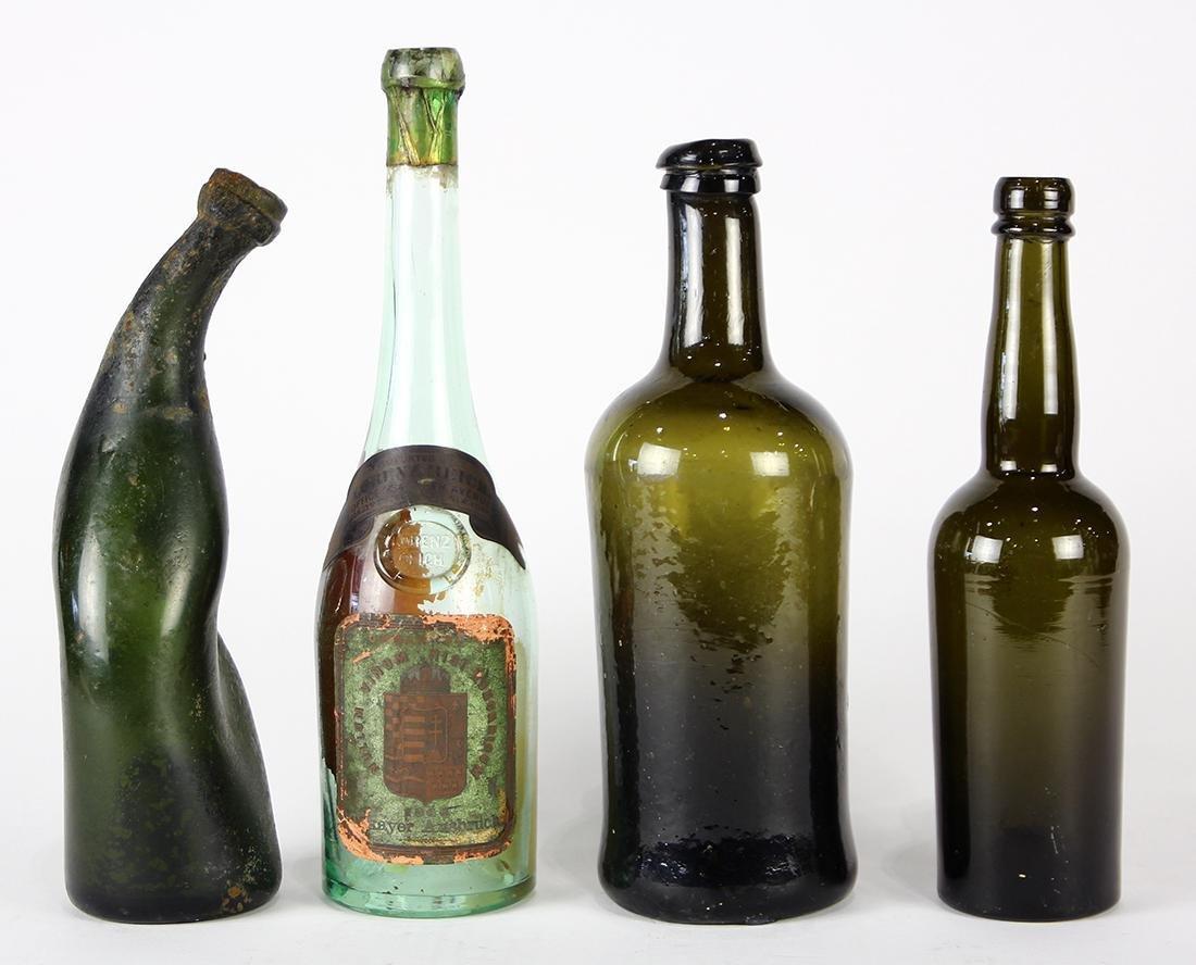 (lot of 4) Early blown glass wine bottles, each having