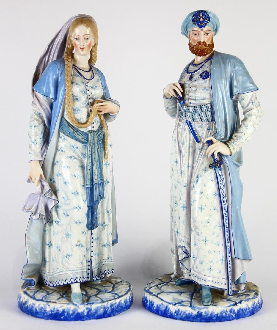 Pair of Russian porcelain figures,  each having a hand