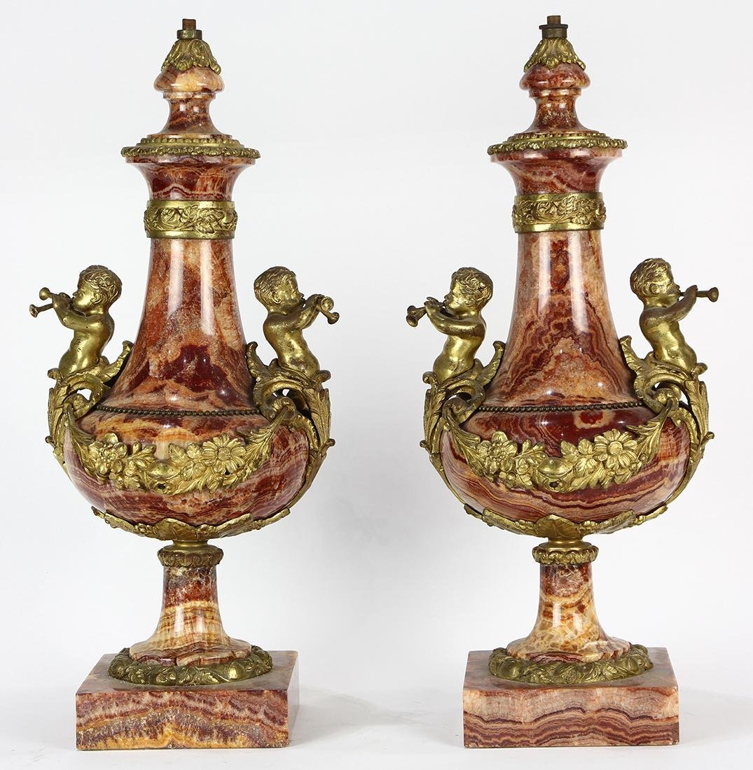 Pair of Louis XV style marble urns, each having a